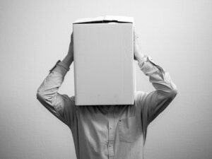 blindfolded with box on the head