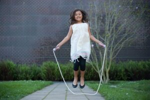 girl jumping in a jump rope