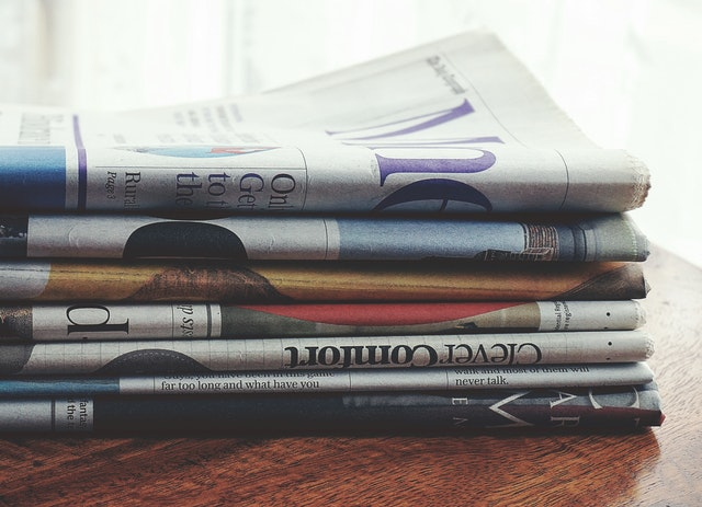 Newspaper stack with Rubik's Cube News